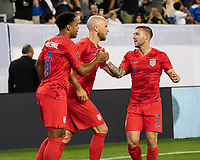 NASHVILLE, TN - JULY 3: Weston Mckennie #8 is congratulated by teammates Michael Bradley #4 and Paul Arriola #7 after his goal during a game between Jamaica and USMNT at Nissan Stadium on July 3, 2019 in Nashville, Tennessee.