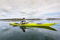 Ulrika Larsson kayaking, West Sweden, Sweden