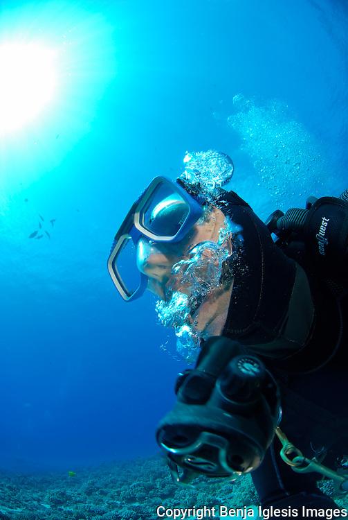 Panic diver losing regulator at mid reef Molokini Maui Hawaii.