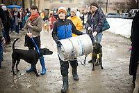 A boy carries a keg back towards the starting line at the 2011 Doggy Keg Pull sponsored by Eichardt's Pub in Sandpoint, Idaho during the Winter Carnival.