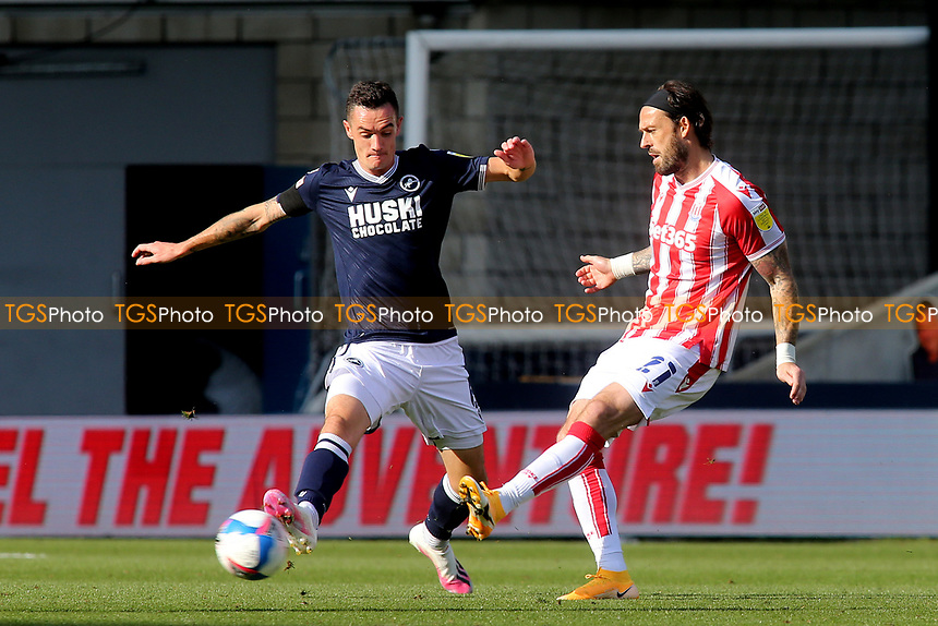 Steven Fletcher of Stoke City in action as Millwall's Shaun Williams tries to block the ball during Millwall vs Stoke City, Sky Bet EFL Championship Football at The Den on 12th September 2020
