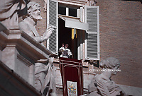 Pope Francis  from the window of the apostolic palace overlooking St Peter's square during the Sunday Angelus prayer, on  January 6, 2020 in Vatican.