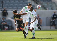 LOS ANGELES, CA - APRIL 17: Matt Besler #5 of Austin FC heads the ball during a game between Austin FC and Los Angeles FC at Banc of California Stadium on April 17, 2021 in Los Angeles, California.