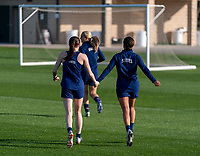 ORLANDO, FL - JANUARY 21: Rose Lavelle #16 and Mallory Pugh #2 of the USWNT run across the field during a training session at the practice fields on January 21, 2021 in Orlando, Florida.