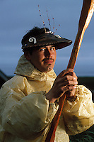 Portrait of a male Native Alaskan Tlingit wearing a traditional hunting hat and Kamleika (raincoat.). Alaska.