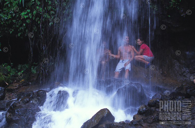 Family at a waterfall on the Kalihiwai River, North Shore of Kauai