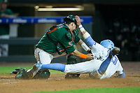 Zack Gahagan (10) of the North Carolina Tar Heels is tagged out at home plate by Miami Hurricanes catcher Joe Gomez (40) in the second semifinal of the 2017 ACC Baseball Championship at Louisville Slugger Field on May 27, 2017 in Louisville, Kentucky.  The Tar Heels defeated the Hurricanes 12-4.  (Brian Westerholt/Four Seam Images)