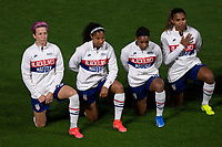 ORLANDO CITY, FL - FEBRUARY 18: Megan Rapinoe #15, Margaret Purce #20, Crystal Dunn #19 and Catarina Macario #11 take a knee during the National Anthem during a game between Canada and USWNT at Exploria stadium on February 18, 2021 in Orlando City, Florida.