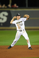 UCF Knights shortstop Brennan Bozeman (21) throws to first base during a game against the Siena Saints on February 17, 2017 at UCF Baseball Complex in Orlando, Florida.  UCF defeated Siena 17-6.  (Mike Janes/Four Seam Images)