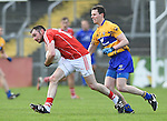 Donncha O Connor of Cork in action against Kevin Harnett of Clare during their National Football League game at Cusack Park. Photograph by John Kelly.