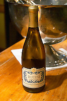 Bottle on a wooden bar counter of Rutini Chardonnay 2003, Bodega La Rural, Maipu, Mendoza The Rosa Negra Restaurant, The Black Rose, Buenos Aires Argentina, South America San Felipe, La Rural Vinedos y Bodegas Winery