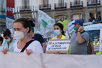 MADRID, SPAIN - JUNE 29: A woman shows a placard  during a protest held in the afternoon in Puerta del Sol to request better working conditions, protection equipment and investment in Health to fight against the covid-19 on June 29 2020, in Madrid, Spain. The region of Madrid was the main focus of covid-19 outbreak in Spain. In al over the country, more than 50000 thousand health staff has been infected with the coronavirus since the beginning of the pandemic.(Photo by Sergio Belena/VIEWpress via Getty Images).