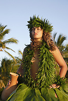 Female (wahine) hula dancer wearing palapalai fern head lei, headshot.