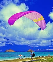 EDITORIAL ONLY. Paragliding off Lanikai, near Kailua,  Oahu. Moku Lua Islands in distance