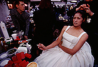 A model smokes and cigarette and studies herself in the mirror while being styled for Expo Boda, a high fashion bridal show.<br /> Monterrey, Mexico's cosmopolitan city, shows its face at the fashion show that features evening wear and bridal gowns. Capital of Nuevo Leon, Monterrey is Mexico's third largest city of 3 million. A modern, industrial city, Monterrey is described as most Americanized--where the pursuit of profit seems more American than Mexican.