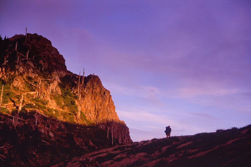 Hiker at Sunset in Mt. Margaret Backcountry, Mt. St. Helens National Volcanic Monument, Washington, US