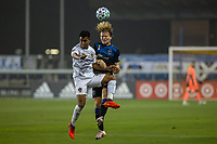 SAN JOSE, CA - SEPTEMBER 13: Efrian Alvarez #26 of the L.A. Galaxy and Florian Jungwirth #23 of the San Jose Earthquakes battle for the ball during a game between Los Angeles Galaxy and San Jose Earthquakes at Earthquakes Stadium on September 13, 2020 in San Jose, California.