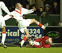 26/12/2004  Copyright Pic : James Stewart.File Name : jspa11_falkirk_v_airdrie.ALAN FERGUSON SAVES AT THE FEET OF WILLIE MCLAREN....Payments to :.James Stewart Photo Agency 19 Carronlea Drive, Falkirk. FK2 8DN      Vat Reg No. 607 6932 25.Office     : +44 (0)1324 570906     .Mobile   : +44 (0)7721 416997.Fax         : +44 (0)1324 570906.E-mail  :  jim@jspa.co.uk.If you require further information then contact Jim Stewart on any of the numbers above.........