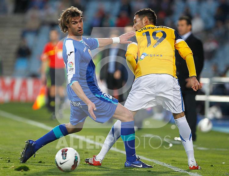 Getafe's Juan Valera (l) and Real Sociedad's Liassine Cadamuro during La Liga match.March 17,2012. (ALTERPHOTOS/Acero)
