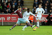 Pictured: Nathan Dyer of Swansea (R) Saturday 10 January 2015<br /> Re: Barclays Premier League, Swansea City FC v West Ham United at the Liberty Stadium, south Wales, UK