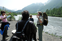 U.S. Forest Service guide Saralynn Fenwick, right, answers a question from Alexandra Clark, left. The Alaska Railroad's Spencer Glacier Whistlestop train gives visitors access to hiking, camping and stunning views.