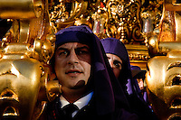 The gold-coated throne is carried on the shoulders of the carriers during the Easter celebration in Malaga, Spain, 3 April 2007.