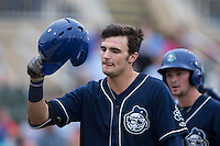 Sam Hilliard (25) of the Asheville Tourists celebrates after hitting a home against the Kannapolis Intimidators at Intimidators Stadium on May 28, 2016 in Kannapolis, North Carolina.  The Intimidators defeated the Tourists 5-4 in 10 innings.  (Brian Westerholt/Four Seam Images)