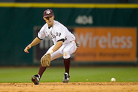 Shortstop Adam Smith #20 of the Texas A&M Aggies eyes up a ground ball versus the Rice Owls in the 2009 Houston College Classic at Minute Maid Park February 28, 2009 in Houston, TX.  The Owls defeated the Aggies 2-0. (Photo by Brian Westerholt / Four Seam Images)