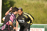 Jerry Collins tries to block Mike Phillips during Ospreys rugby training at Llandarcy Institute of Sport near Neath aheah of their Heineken Cup match with Clermont Auvergne on Sunday..