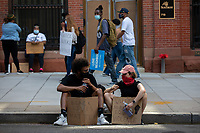 Two protesters take a break during a march against police brutality and racism in Washington, D.C. on Saturday, June 6, 2020.<br /> Credit: Amanda Andrade-Rhoades / CNP/AdMedia