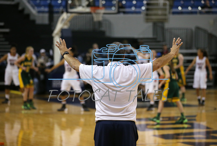 Liberty Patriots Head Coach Rich Santigate signals his players in a Division I semi-final game at the NIAA basketball state tournament at Lawlor Events Center, in Reno, Nev., on Thursday, Feb. 27, 2014. Liberty defeated Bishop Manogue 43-33. (Cathleen Allison/Las Vegas Review-Journal)