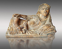 Etruscan Hellenistic style cinerary, funreary, urn  cover,  National Archaeological Museum Florence, Italy , against grey