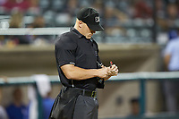 Home plate umpire Lane Culipher updates his lineup card during the Appalachian League playoff game between the Burlington Royals and the Pulaski Yankees at Calfee Park on September 1, 2019 in Pulaski, Virginia. The Royals defeated the Yankees 5-4 in 17 innings. (Brian Westerholt/Four Seam Images)