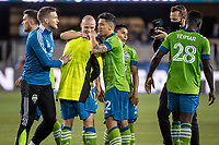 SAN JOSE, CA - MAY 12: Shane O'Neill #27 and Fredy Montero #12 of the Seattle Sounders congratulate Alex Roldan #16 for the shut out during a game between San Jose Earthquakes and Seattle Sounders FC at PayPal Park on May 12, 2021 in San Jose, California.