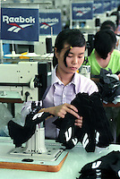 Female workers sew Reebok shoes in a factory in Zhuhai, China.