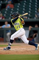 Right fielder Guillermo Granadillo (23) of the Columbia Fireflies bats in a game against the Hickory Crawdads on Tuesday, August 27, 2019, at Segra Park in Columbia, South Carolina. Columbia won, 3-2. (Tom Priddy/Four Seam Images)