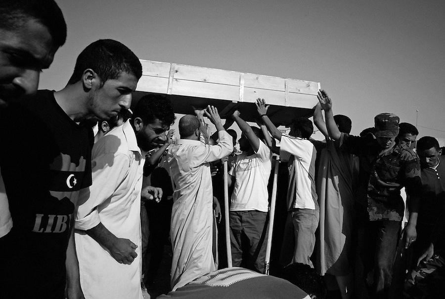 Casket is brought for burial during funeral ceremony in Zintan, Libya