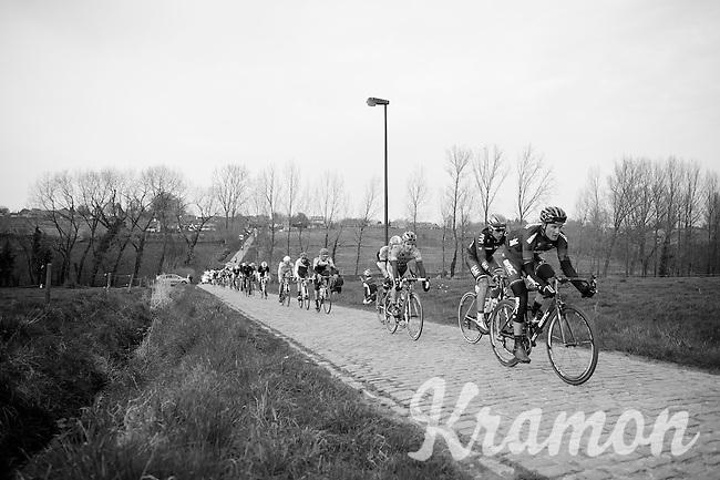 25 men strong breakaway group over the cobbles of the Haaghoek<br /> <br /> Dwars Door Vlaanderen 2014