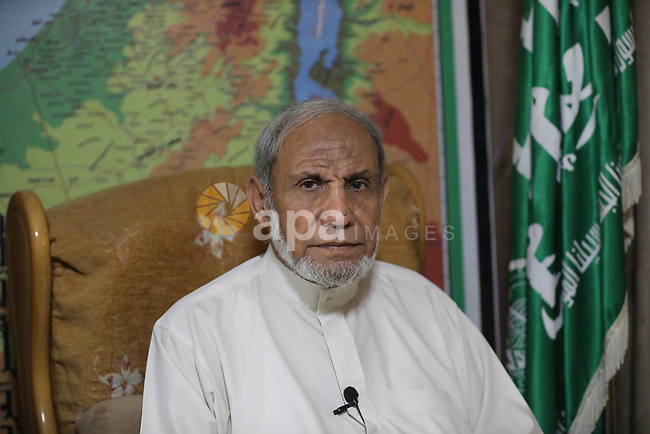 Senior Hamas leader Mahmoud Al-Zahar poses for photo at his home in Gaza city on August 09, 2021. The Saudi court issued verdicts against 69 Palestinians with sentences ranging from 3-22 years without allowing relatives of detainees to attend the trial. Photo by Ashraf Amra