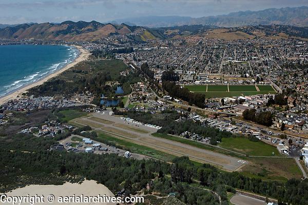 aerial photograph of the Oceano County Airport (L52), Oceano, San Luis Obispo County, California; Grover Beach, Arroyo Grande and Pismo Beach in the background