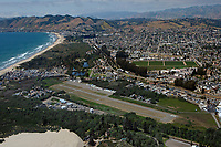 aerial photograph of the Oceano County Airport (L52), Oceano, San Luis Obispo County, California; Grover Beach, Arroyo Grande and Pismo Beach in the background