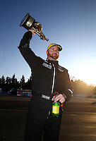 Feb 8, 2015; Pomona, CA, USA; NHRA top fuel driver Shawn Langdon celebrates after winning the Winternationals at Auto Club Raceway at Pomona. Mandatory Credit: Mark J. Rebilas-