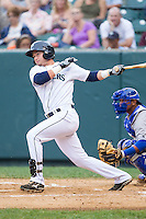 Jay Baum (17) of the Pulaski Mariners follows through on his swing against the Burlington Royals at Calfee Park on June 20, 2014 in Pulaski, Virginia.  The Mariners defeated the Royals 6-4. (Brian Westerholt/Four Seam Images)
