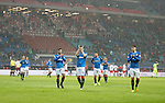 The players come across and applaud the travelling Rangers fans