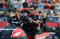 Apr. 27, 2012; Baytown, TX, USA: NHRA crew members for funny car driver Cruz Pedregon during qualifying for the Spring Nationals at Royal Purple Raceway. Mandatory Credit: Mark J. Rebilas-