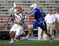 George Huguely (11) of Virginia is checked by Tom Montelli (11) of Duke during the ACC men's lacrosse tournament semifinals in College Park, MD.  Virginia defeated Duke, 16-12.
