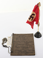 BNPS.co.uk (01202) 558833. <br /> Pic: C&TAuctions/BNPS<br /> <br /> Pictured: Along with the cream jug Corporal Whitney also managed to get a Nazi penant and this binder listing the Fuhrer's musical choices. <br /> <br /> A selection of rare items salvaged from Adolf Hitler's personal train by a British officer have emerged for sale 76 years on.<br /> <br /> A member of Field Marshal Bernard Montgomery's security staff brought home a range of souvenirs including his cream jug at the end of World War Two.<br /> <br /> Corporal Whitney also got his hands on a small binder which listed the Fuhrer's musical choices to be played on a gramophone, and a Nazi penant.