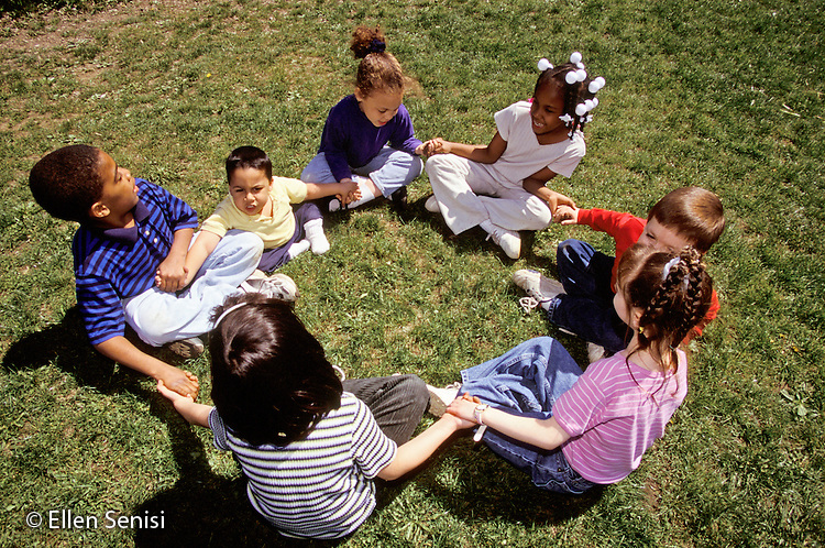 MR / Schenectady, NY.Zoller Public School- Inclusion Class Grade 1.Friends in circle on playground hold hands; diverse group includes African-American, Hispanic, Afghan, and Caucasain and two with disablilties: (spina bifida and scoliosis)..MR: MF.PN#: 29888                       FC#: 23675-01109.scan from slide.©Ellen B. Senisi