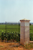 Iron gate and stone pillar to Criots-Batard Montrachet, grand cru, Roger Belland, Bourgogne