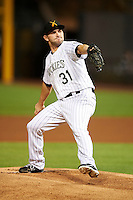 Salt River Rafters pitcher Tyler Chatwood #31, of the Colorado Rockies organization, during an Arizona Fall League game against the Mesa Solar Sox at Salt River Fields at Talking Stick on October 9, 2012 in Scottsdale, Arizona.  Salt River defeated Mesa 6-5.  (Mike Janes/Four Seam Images)